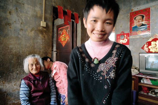 83-year-old Mei Lin is the breadwinner and caregiver of four mentally ill relatives. Below, Zhendon Liang, 15, was expelled from primary school in 2009 over the fear he would have a negative impact on fellow students.