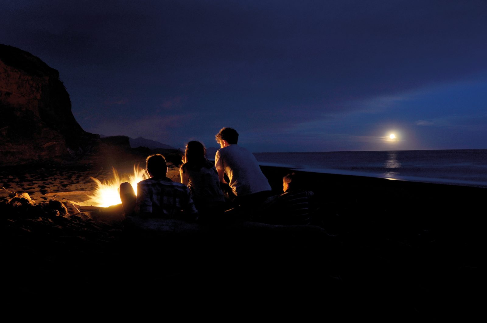 There's nothing more kiwi than a bonfire on the beach at Conway Flats.