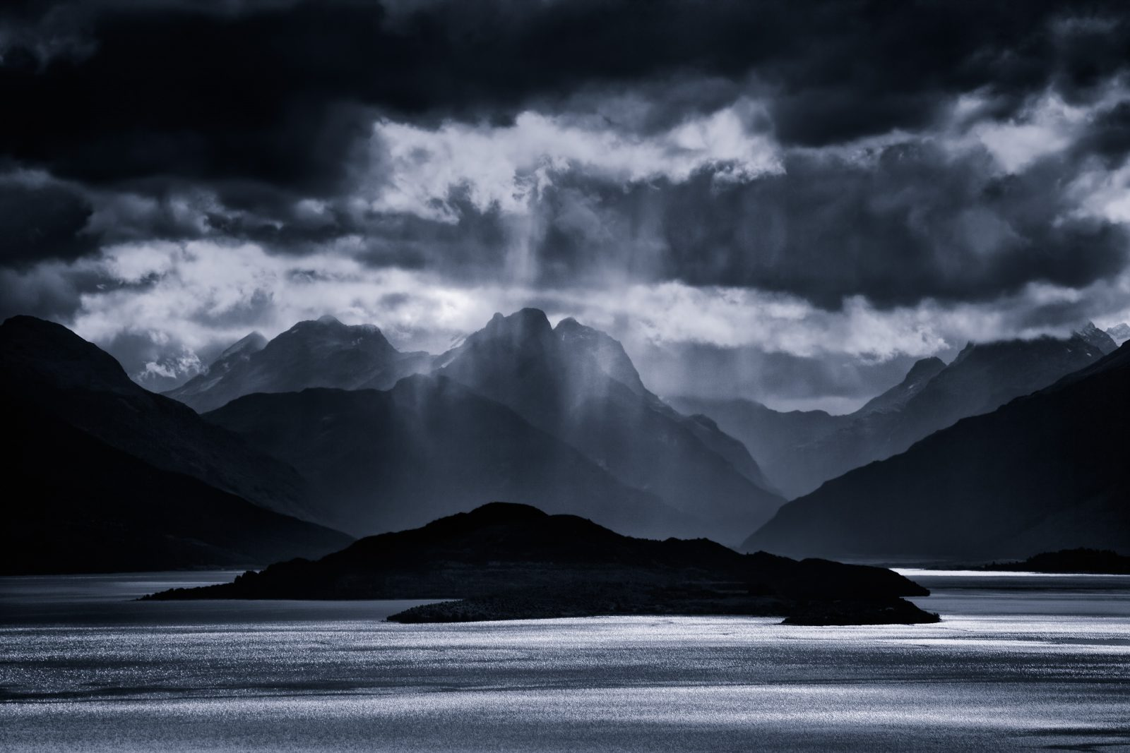 "The 40-minute drive from Queenstown to Glenorchy hugs the coast of Lake Wakatipu. Kah Kit Yoong took his time on the journey. Under an ""ethereal light"", he set up a tripod to photograph storm clouds over the lake. ""I enjoy this photo just as much as the day I made it,"" he says. ""Timelessness is a quality that I have found elusive, so I treasure it all the more."""