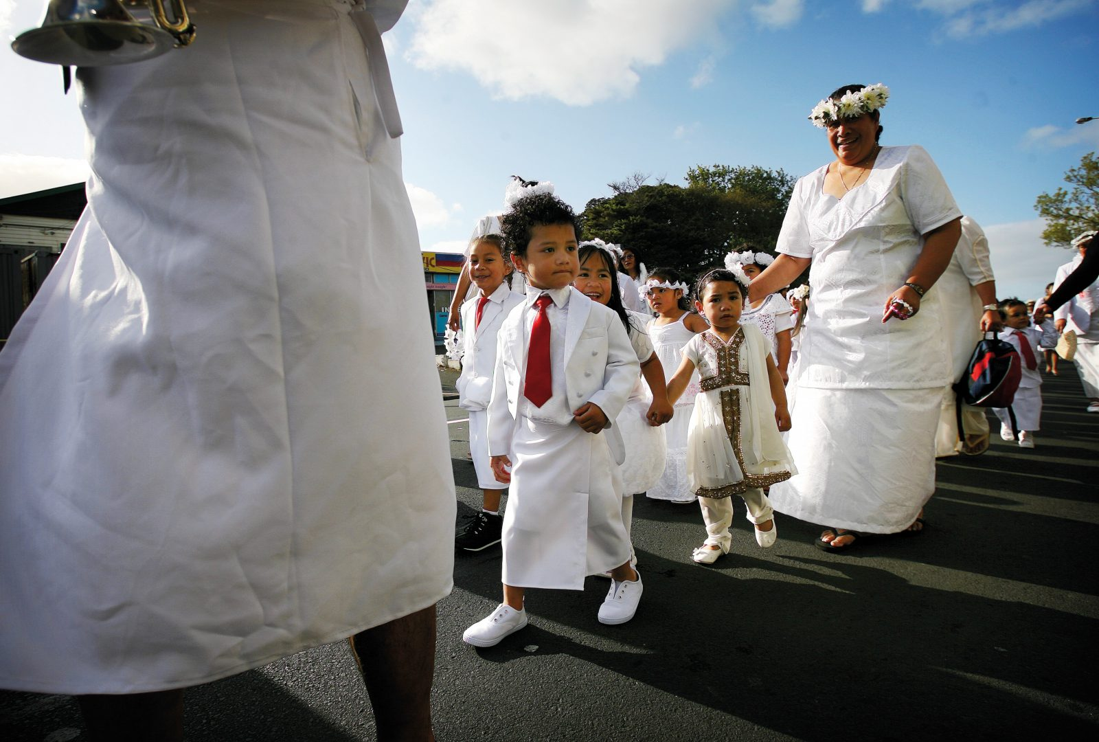 The 2011 White Sunday celebrations in Auckland began with a procession of around 100 children and parents along Great North Road to Avondale Union Parish church. White Sunday, or Lotu Tamaiti, is among the most important dates in the Samoan religious calendar. Children enjoy special privileges, such as speaking in church and being served first at the lunch feast. White is worn to symbolise the purity of a child's heart.