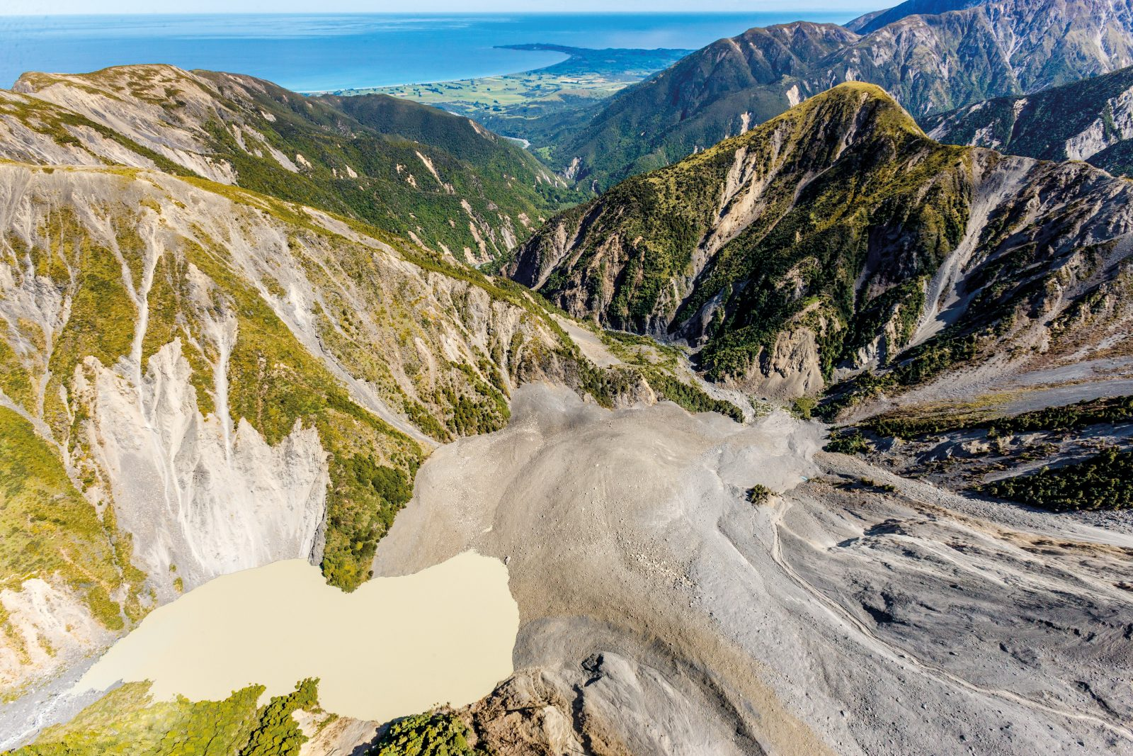The earthquake and subsequent aftershocks sent 80–100,000 landslides tumbling down mountainsides in Marlborough and Canterbury—presenting an ongoing danger for those downstream. This one blocked the Hapuku River, creating a dam 150 metres high and completely burying Barratt's bivvy, a tiny DOC hut beloved by climbers. Landslide experts are monitoring this and other dams, using computer modelling to anticipate the risks if and when they break.