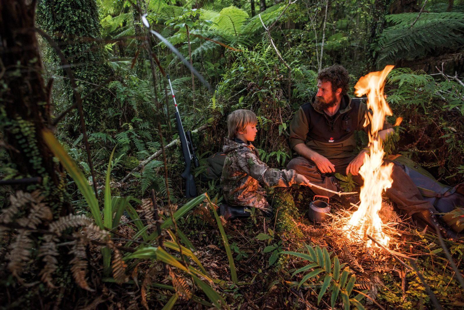 "Another night in the woods of Haast for the James boys, and another opportunity to school his son in the demanding curriculum provided by wild places. ""I think it's good for everyone to sleep alone in the bush,"" says James. ""Not in a tent, with the security of the walls, but under the stars. It's scary, we've all got our demons and our dark spots, but it's good for you."""