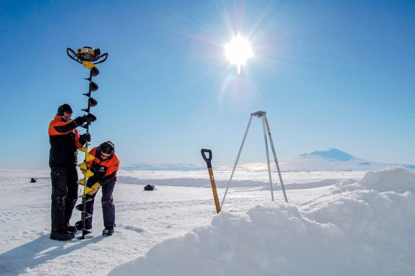 Under the shadow of Mt Erebus, NIWA scientist Natalie Robinson and Mike Rowe work on the Ross Ice Shelf, the world's largest slab of floating ice, drilling a hole to study the physics of sea ice and ice platelets. During last summer's science season, Robinson spent five weeks camping in shipping containers on three-metre-thick sea ice as part of her mission to understand how the shelf can be growing bigger while the Southern Ocean is warming.