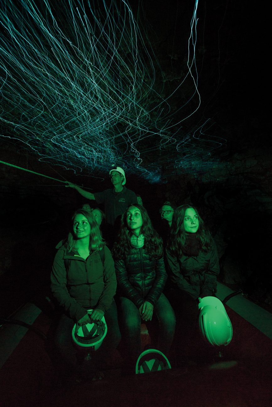 "After selling the black-water rafting company he started to THL, Pete Chandler launched a new venture, Spellbound, which specialises in leisurely, intimate tours. In 2006 he was awarded the New Zealand Order of Merit for his contribution to tourism. Pictured right, he guides visitors by boat through the Mangawhitiakau cave system. ""I think the Waitomo Glowworm Cave in its crowded state is not really a good advertisement for cave tourism,"" he says. ""It's all about how many people they can push through."""